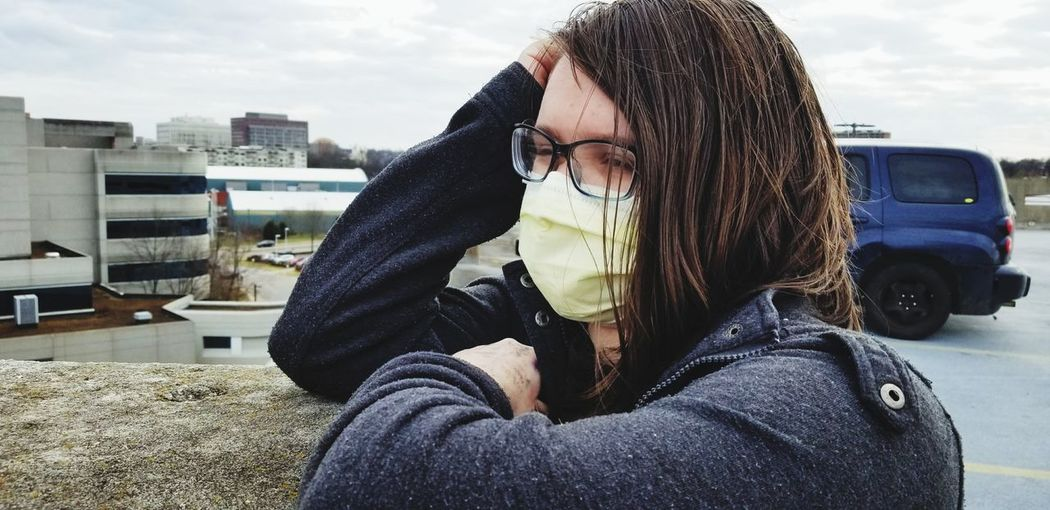 Girl looking away while wearing face mask