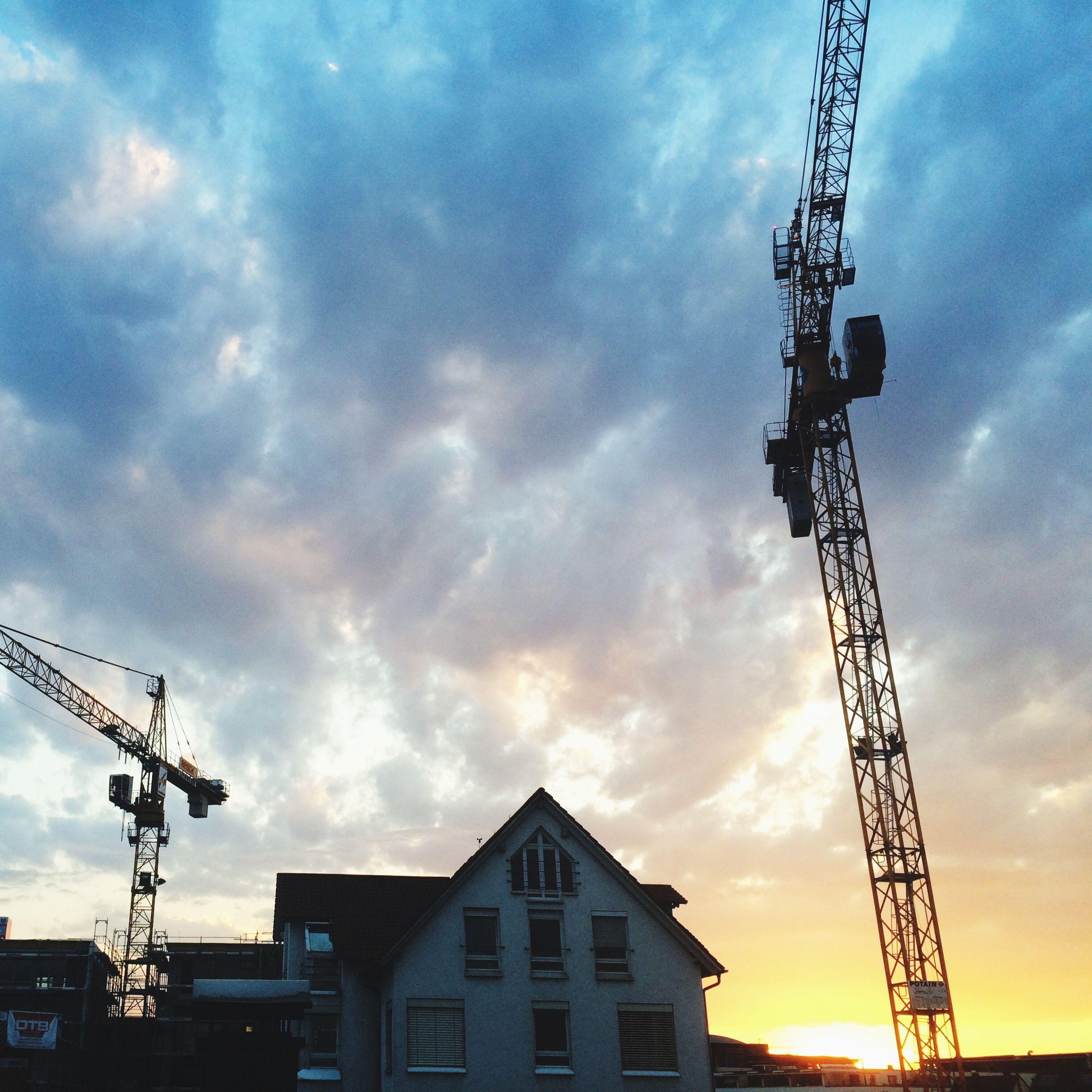 architecture, building exterior, built structure, sky, low angle view, cloud - sky, construction site, crane - construction machinery, sunset, cloudy, silhouette, development, crane, cloud, electricity pylon, industry, city, construction, power line, dusk