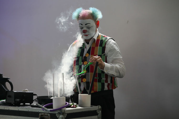 Modern Modern Workplace Culture Smoking Adult Clown Day Holding Illusionist Indoors  Job Jobs Magician Men New Job  Occupation One Man Only One Person People Real People Standing Young Adult EyeEmNewHere