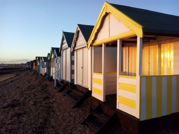 Beach huts catching the evening sun. Beach Hut Beach Huts Beach Southend On Sea EyeEm Selects Beach Sand Travel Destinations Business Finance And Industry Vacations Outdoors Day