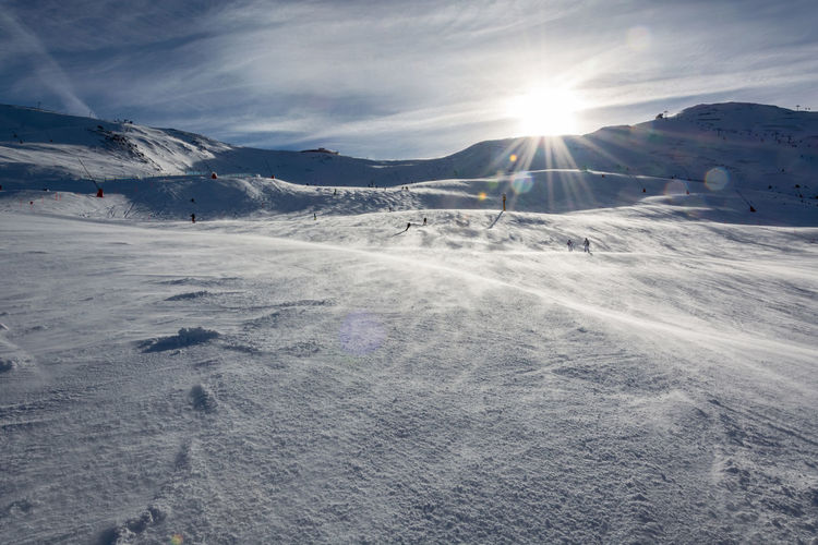 Beauty In Nature Bright Cold Temperature Day Environment Landscape Lens Flare Mountain Mountain Range Nature No People Scenics - Nature Ski Resort  Sky Snow Snowcapped Mountain Sun Sunbeam Sunlight Tranquil Scene Tranquility Winter