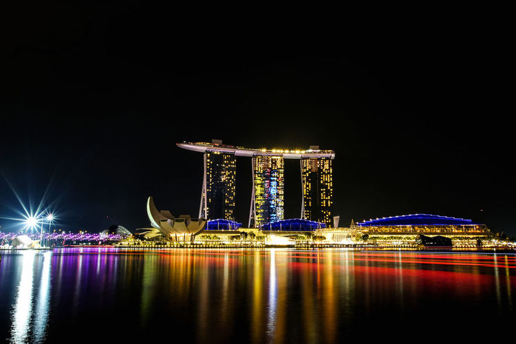Marina Bay Sands , Singapore Marina Bay Sands Marina Bay Sands Hotel Marina Bay Singapore Singapore Singapore View Architecture Bay Building Building Exterior Built Structure City Hotel Illuminated Laser Luxury Merlion Singapore Modern Night Nightlife No People Office Building Exterior Outdoors Reflection River Sea Singapore City Sky Skyscraper Tall - High Travel Destinations Water Waterfront