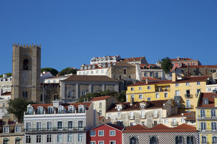 Architecture Bossanova Building Exterior City Cityscape Clear Sky Colourful Day Harbour History Horizontal Lisboa Lisbon Medieval No People Outdoors Port Portugal Residential Building Roof Sky Travel Destinations Urban Skyline Vibrant Vibrant Color