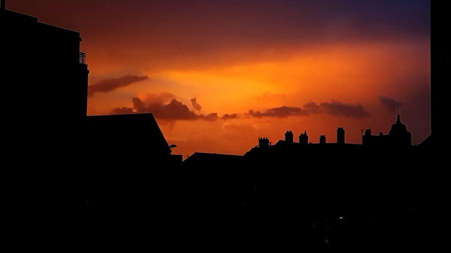 """Sometimes, quiet is violent"" Urban Skyline Sunset Silhouette Sky Thunderstorm Dramatic Sky Atmospheric Mood Cityscape Storm Cloud"