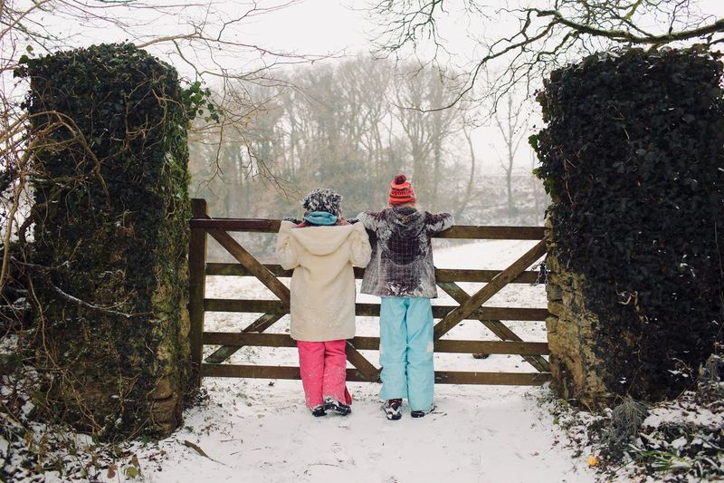 Searching for a sledging spot Portait People Walking Winter Gate Countryside Snow Tree Real People Day Full Length Leisure Activity Outdoors Standing Togetherness Nature Warm Clothing Two People Cold Temperature