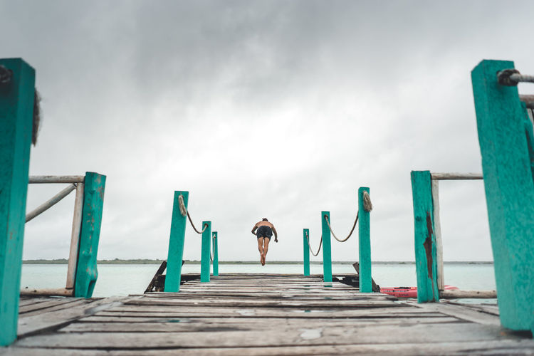 One Person Sky Lifestyles Real People Leisure Activity Architecture Nature Pier Wood - Material Standing Day Adult Water Men Outdoors