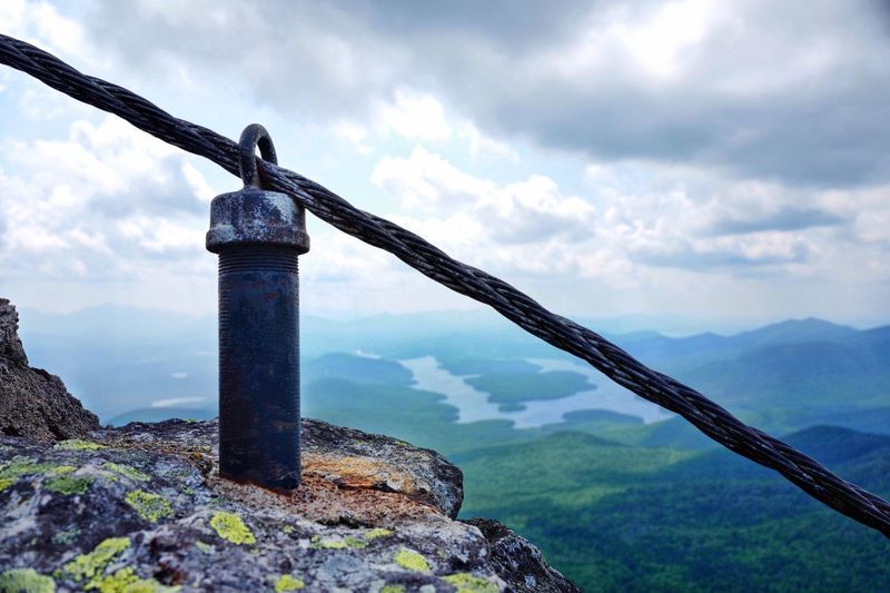 EyeEm Nature Lover Cable Connection Cable Rocky Mountains Rock - Object Rock Beauty Of Nature Natural Beauty Nature Cloud - Sky Sky Nature Day Water No People Architecture Built Structure Mountain Scenics - Nature Tranquility Tranquil Scene Beauty In Nature Solid Non-urban Scene Metal Outdoors