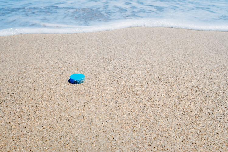 High angle view of ball on beach