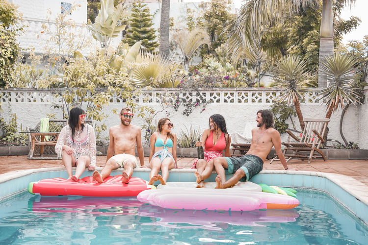 Happy friends making swimming pool party - Young people having fun on summer holidays vacation - Travel, friendship, youth and tropical concept - Focus on guys faces Millennials Millenials Young People Friends Party Swimming Pool Pool Water Males  Real People Men Leisure Activity Childhood Females Enjoyment Boys Group Of People Togetherness Women Trip Lifestyles Daughter