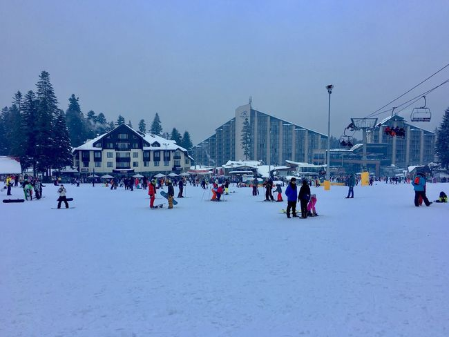 Architecture Building Exterior Built Structure Cold Temperature Crowd Day Group Of People Large Group Of People Leisure Activity Lifestyles Men Nature Outdoors Real People Sky Snow Sport Winter Winter Sport