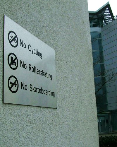 Fun Prohibited 🚫 Text Communication Built Structure Architecture Day No People Outdoors Building Exterior Close-up Politics And Government Rules Modern City Urban No Fun No Restriction Building Rules No Cycling No Skateboarding No Skating No Rollerskating