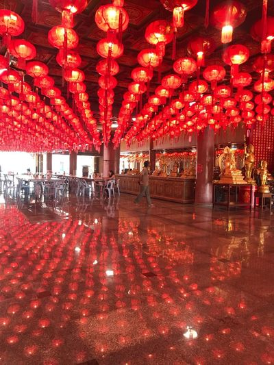 Red Illuminated Architecture Lighting Equipment Built Structure Decoration Lantern Holiday Chinese Lantern Incidental People Outdoors Building Exterior City Celebration Flooring Real People Architectural Column Group Of People Night Building