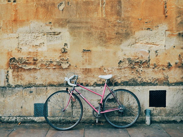Pink Pink Bike Sandstone Sandstone Wall Facades Facadelovers Architecture Architecture_collection Soloparking Solobikeparking Bike Bike Parking Vintage Bicycles Vintage Bike Bicycle