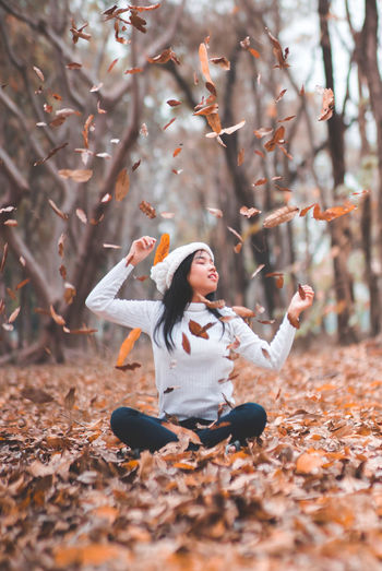 Autumn shows us how beautiful it is to let things go. Autumn Autumn Collection Autumn colors Autumn Leaves Autumn Autumn🍁🍁🍁 Beauty In Nature Day Full Length Human Hand Leaf Lifestyles Nature One Person Tree Women Young Women