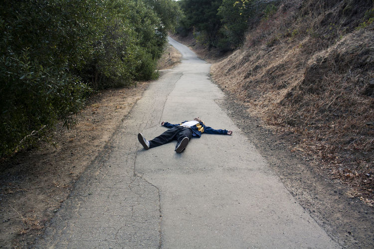 Man Lying On Road