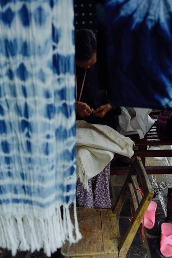 China Guizhou Qiandongnan Minority TieDyeing Handicraft Handworking Textile Indoors  Seat Clothing Selective Focus Day Blue Handworking Textile Indoors  Seat Clothing Selective Focus Day Blue