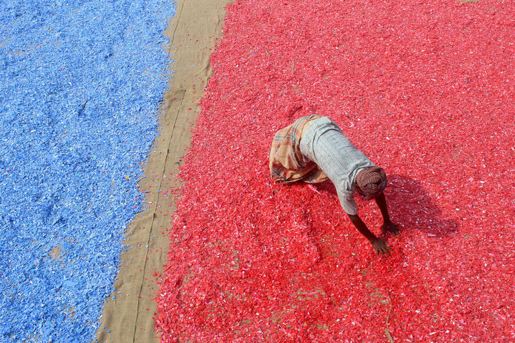 High angle view of a man working with colorful plastics