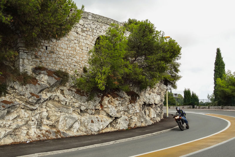 """Oct 2012 - """"Open Road"""" 2 Laned Road Curve Daytime Mediterranean Landscape Motorcycle Helmet High Speed Leisure Activity Mideval Motorcycle Riding Riding Stone Wall"""