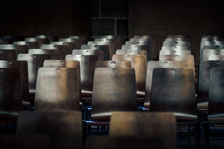 Empty chairs arranging in darkroom