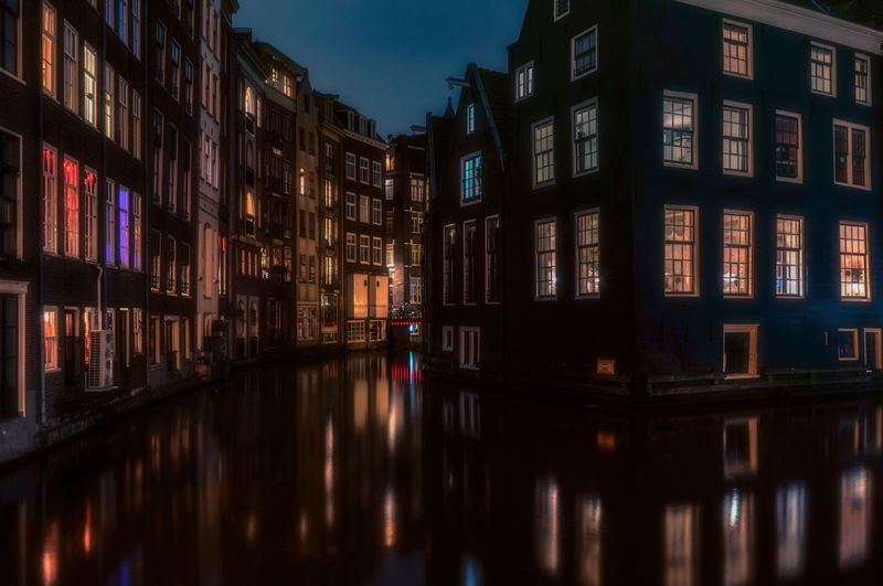 Reflection Of Buildings On Canal At Night