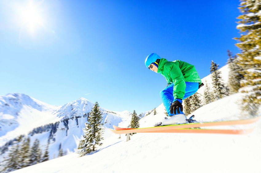 Winter fun Action Air Austria Fun Happy Healthy Lifestyle Holidays Jumping Men Motion Mountains Nature One Person Outdoors People Ski Skiing Sky Slope Snow Sport Sports Teenage Boy Winter Young Men