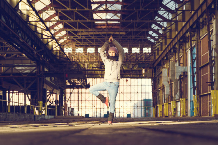 Yoga everywhere One Person Architecture Real People Lifestyles Leisure Activity Vitality Young Adult Exercising Sport Healthy Lifestyle Yoga Yoga Pose Yogagirl Yoga Practice Everywhere Yoga Everywhere Every Day Yogi Factory Factory Building
