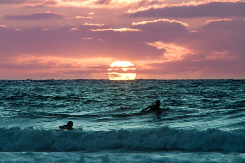 Surfers at sunset Colorful Sea Sky Water Nature Horizon Over Water Beauty In Nature Silhouette Sunset Wave Scenics Cloud - Sky Beach Real People Vacations Extreme Sports Adventure Surfing Outdoors EyeEmNewHere EyeEmNewHere