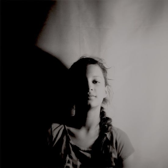 Portrait of teenager against wall