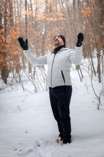 Full length of person standing on snow covered field