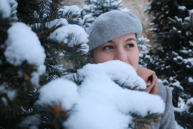 Beutiful young woman with blue eyes in the snow
