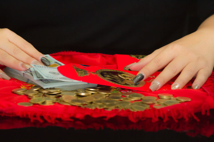 Cropped Hands Of Woman With Coins