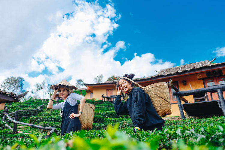 Cloud - Sky Plant Sky Adult Nature Women Lifestyles Architecture Growth Leisure Activity Built Structure Two People Real People Agriculture Three Quarter Length Day Land Grass Men Togetherness Outdoors