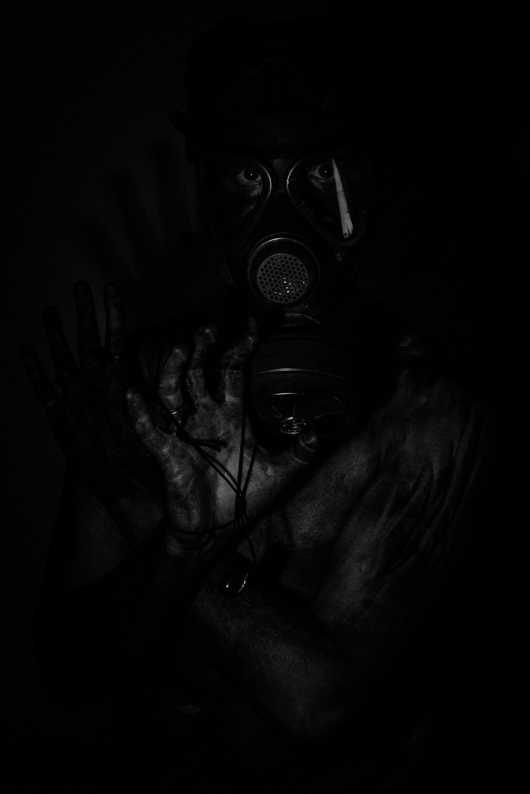 gas mask, human body part, human hand, danger, human face, men, indoors, one person, close-up, people