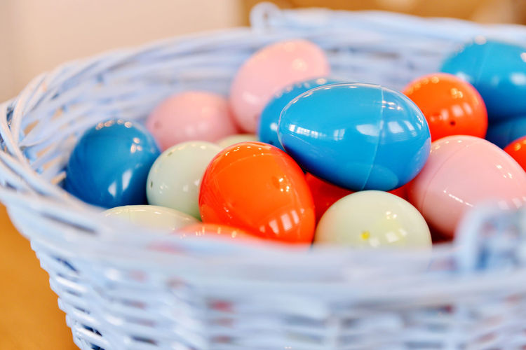 Close-up of multi colored eggs in bowl