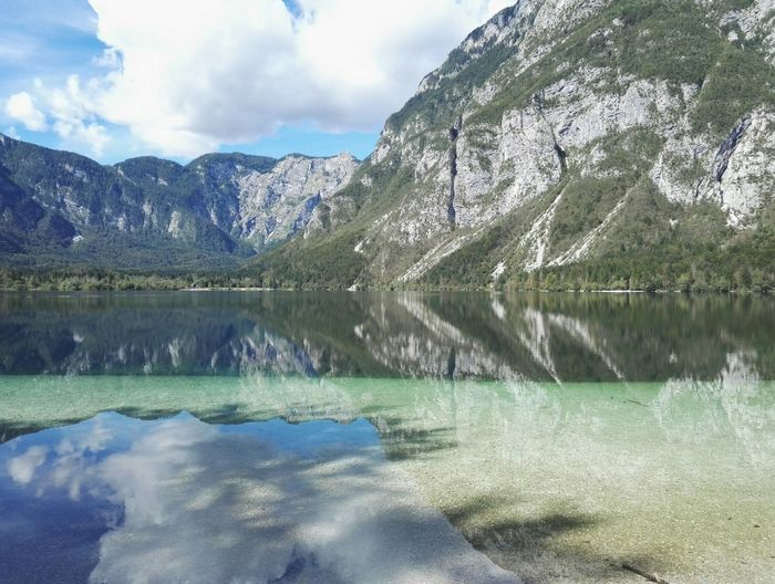 Water Reflection Tranquil Scene Scenics Tranquility Lake Waterfront Beauty In Nature Mountain Nature Majestic Sky Calm Remote Idyllic Non-urban Scene Standing Water Cloud - Sky Day Mountain Range Slovenia ❤ Bohinj, Slovenia Bohinjsko Jezero