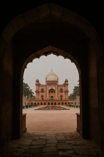 View of historical building seen through arch