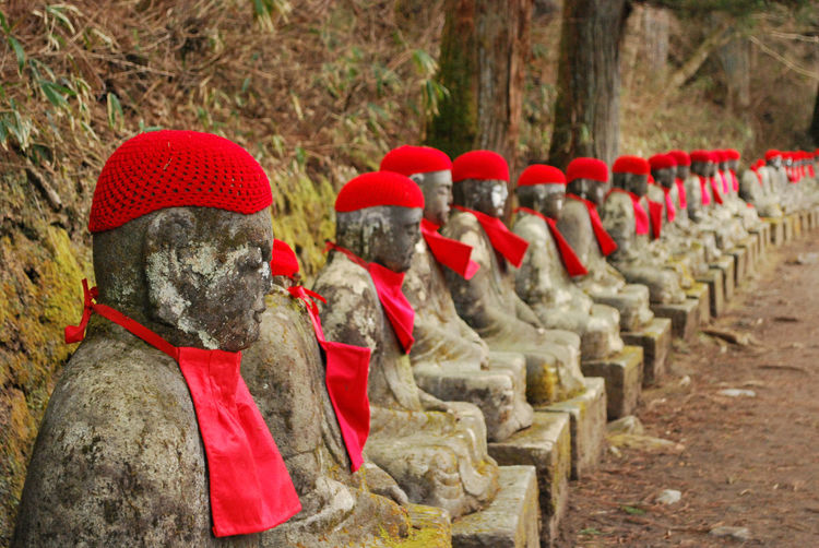 Sculptures with red knitted hat at nikko national park
