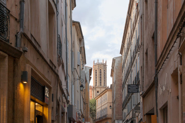 Narrow street leading to The Cathédrale St-Sauveur (Holy Savior Cathedral), Aix-en_Provence Architecture Building Building Exterior Building Story Built Structure City City Life Cloud Cloud - Sky Development Low Angle View No People Outdoors Residential Building Residential District Sky Skyscraper Tall - High Tower Window