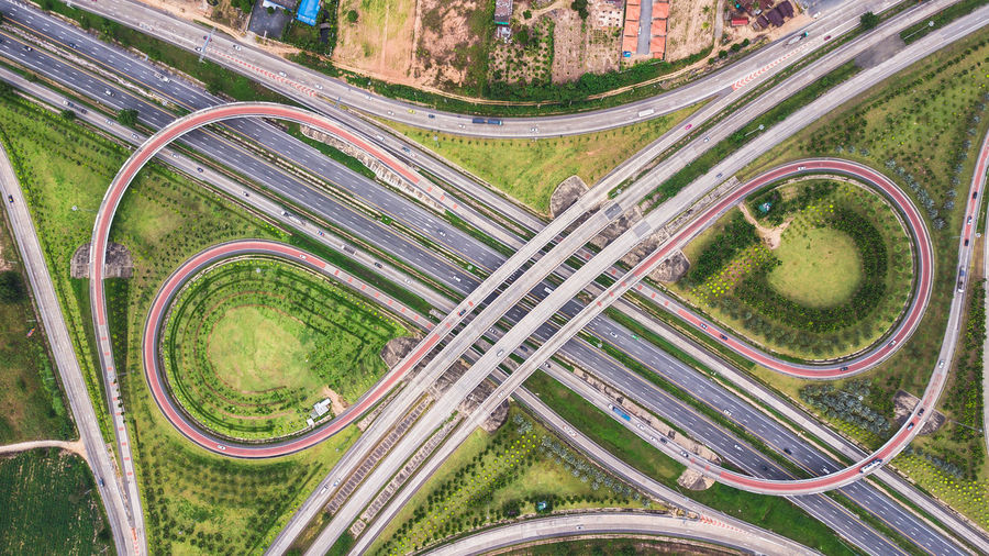 Road Transportation High Angle View Plant City Highway Mode Of Transportation Aerial View No People Overpass Land Vehicle Nature Street Day Curve Motion Speed Architecture Road Intersection Green Color Multiple Lane Highway Outdoors