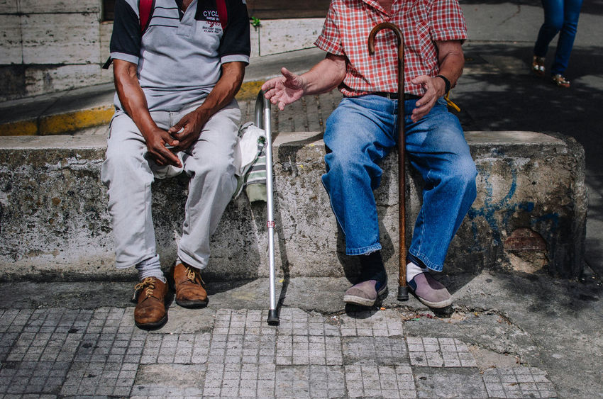 Men talking Low Section Two People Men Casual Clothing Standing Adult Human Leg People Shoe Human Body Part Jeans Day Outdoors Body Part Real People Architecture Footpath Street City Holding Human Limb Eyerm Best Shots EyeEm Selects Human Connection