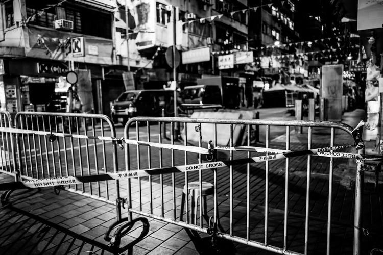 View of shopping cart on street in city