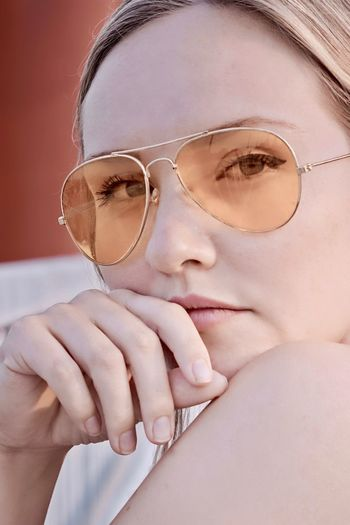 Close-Up Portrait Of Beautiful Young Woman Wearing Sunglasses