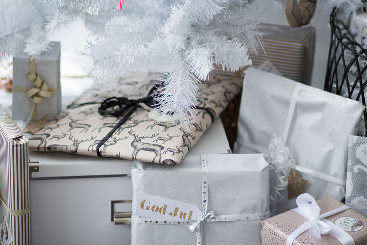 Celebration Christmas Holiday Indoors  Box - Container Gift Box Decoration Close-up No People Still Life Text Ribbon - Sewing Item Ribbon White Color Paper Gift Box Bow Tied Bow Christmas Ornament Softness Sweden Wrap It Up Christmas Gift Merry Christmas