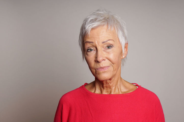Best Ager Copy Space Headshot Looking At Camera Mature Adult Mature Woman Older Person People Person Portrait Sceptic Sceptical Senior Serious Skeptic Skeptical Smirk Studio Woman