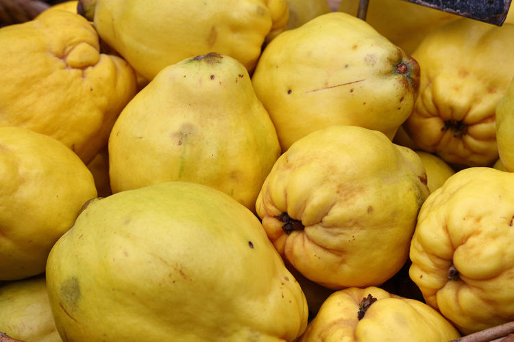 Full frame shot of quinces for sale in market