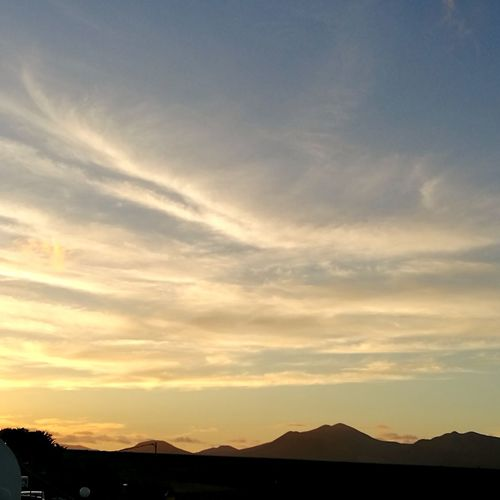 Mountain Sunset Silhouette Sky Landscape Mountain Range Cloud - Sky View Into Land Dramatic Sky Desert Sand Dune Arid Climate Sky Only