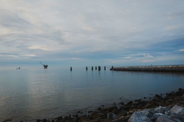 Pier Mobile Bay Alabama Fort Morgan Ocean Water Beauty In Nature Sky Cloud - Sky Scenics - Nature Sea Tranquility Tranquil Scene Nature Non-urban Scene Rock Day Beach No People The Great Outdoors - 2018 EyeEm Awards