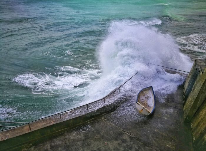 High angle view of waves splashing on promenade