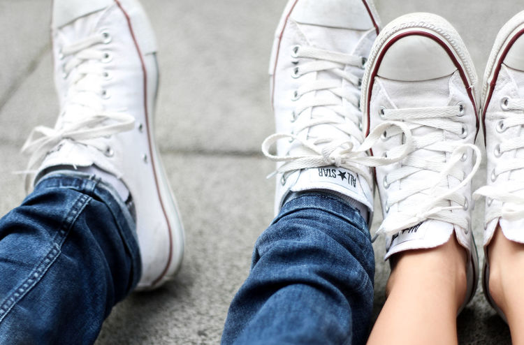 Converse Couple Adult Canvas Shoe Casual Clothing Close-up Converse All Star Couple - Relationship Day Friendship High Angle View Human Body Part Human Leg Indoors  Jeans Leisure Activity Lifestyles Love Low Section Men People Real People Shoe Shoes Sitting Standing Togetherness Two People