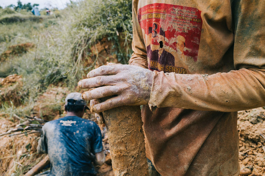 Hands dirty to find shiny. As brilliant coming from the muddy earth. | from my last visit to diamond mine in Cempaka, South Borneo. Adults Only Close-up Human Body Part Human Hand Men Midsection Mine Miner People Real People Togetherness Work This Is Masculinity